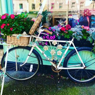 Couldn't resist this cutesy little bicycle outside a shop in #tynemouth #tyneandwear   I'm on another road trip, this time around #northumberland_uk in the NE of England. Today was the hottest day of the year and so I went to the beach. Tomorrow I pack my tent into the car and head out in the country.  ☀️ 🏖 ☀️  #themadwomanintheattic #girlswhotravelsolo #myjourney #roadtripengland #newcastleupontyne