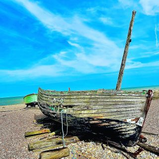 So if it's Tuesday then I must be on another #roadtrip  This week I'm in #dungeness on the coast of #kent. Dungeness has a nature reserve, a nuclear power station and a house that once belonged to filmmaker Derek jarman, but I'm choosing to share a tatty boat on the beach  ☀️ 🚗 ☀️  #themadwomanintheattic #roadtripuk #greatbritain #travelengland #kentlife #englishdaytrips